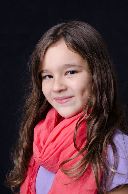 A lovely headshot image of a young girl during an indoor child portrait session in montreal