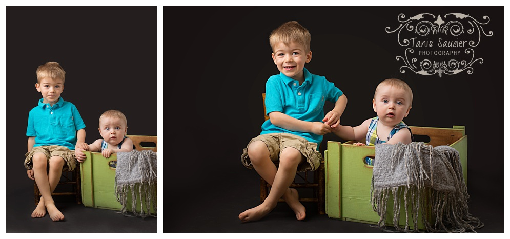 Young brothers pose together in studio with Tanis Saucier Photography during a children's photography session in Montreal.