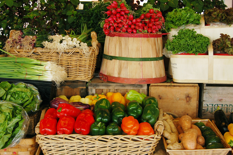 an image of baskets of fresh produce at a local farmer