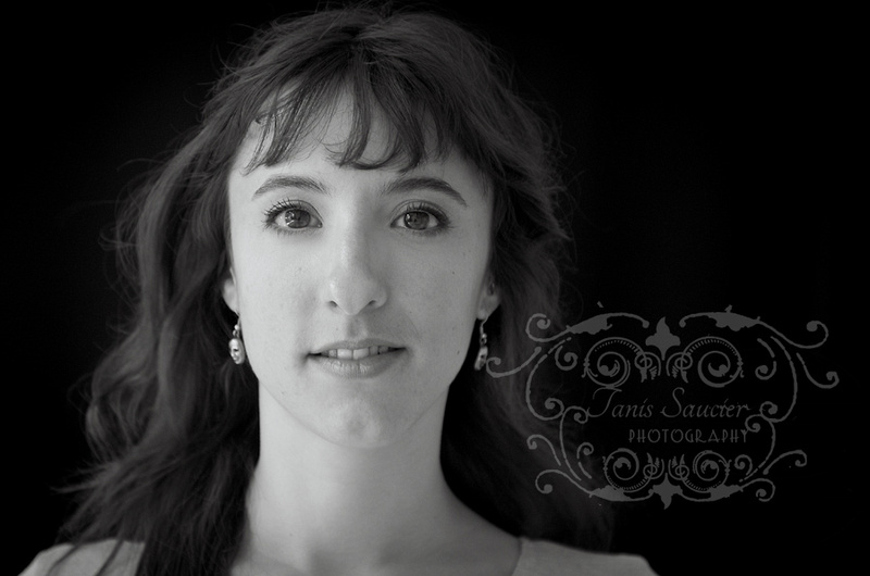 A lovely low key, black and white image of a young woman