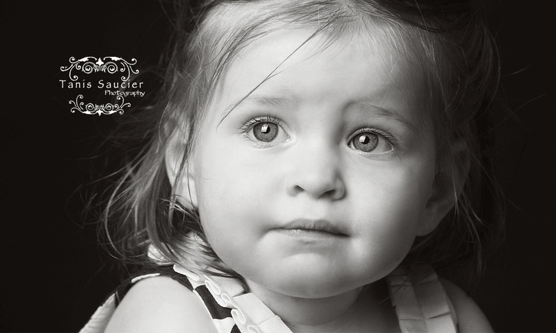A beautiful, close-up black and white image of a little girl