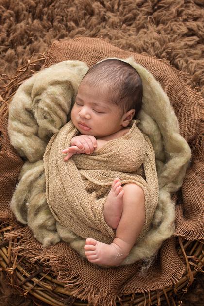 newborn baby girl in Tanis Saucier Photography's studio in Montreal