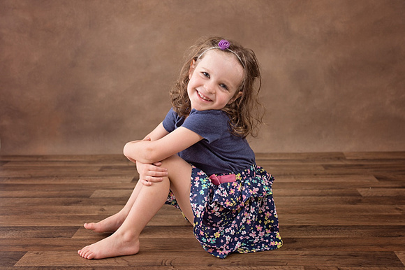 An image of a sweet, smiling girl during her portrait session in Montreal.  www.tanissaucier.com