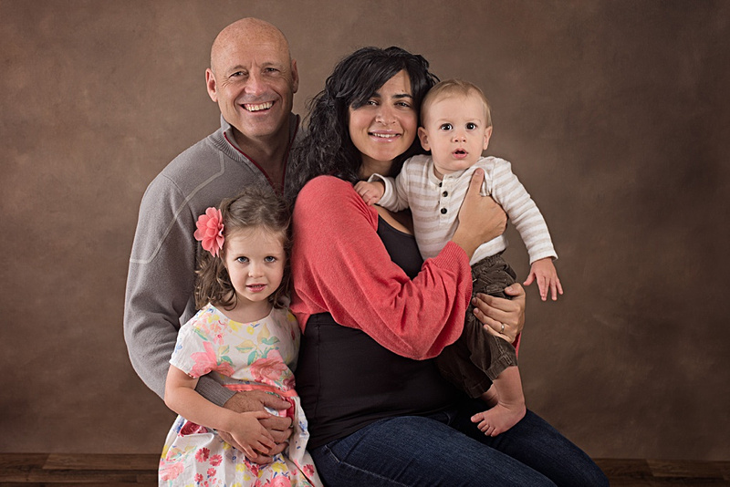 A gorgeous portrait of a family of 4 during their session with Tanis Saucier Photography. #heartfeltparenthood www.tanissaucier.com