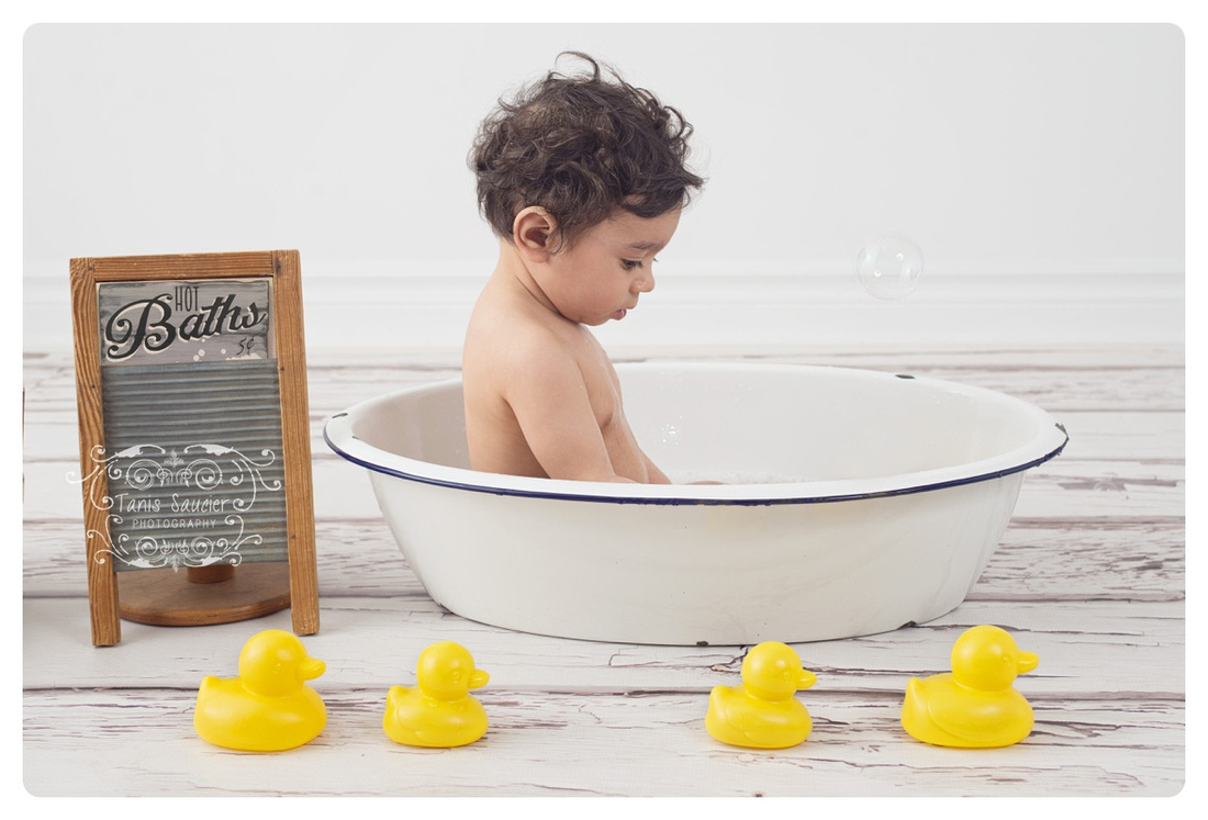 One-year-old Baby Boy Milestone in Bathtub with Washboard and Rubber Duckies