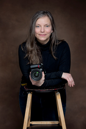 Tanis Saucier poses for a self portrait to promote her portrait photography studio located in Saint-Sauveur, Quebec