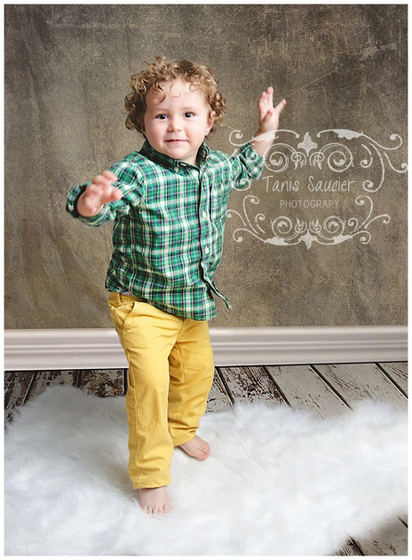 An image of a young boy jumping on a soft, cloud like carpet