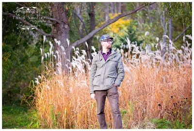image of a handsome dad standing in a field in an outdoor fall family session in Saint Sauveur, Quebec with Tanis Saucier Photography.