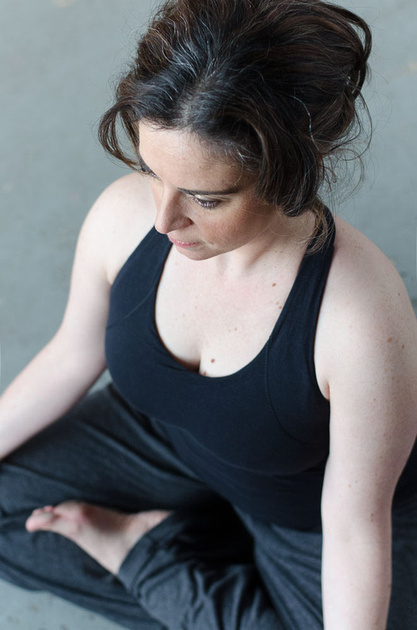 A bird's eye view of a woman doing the lotus pose in yoga during her montreal studio photo session