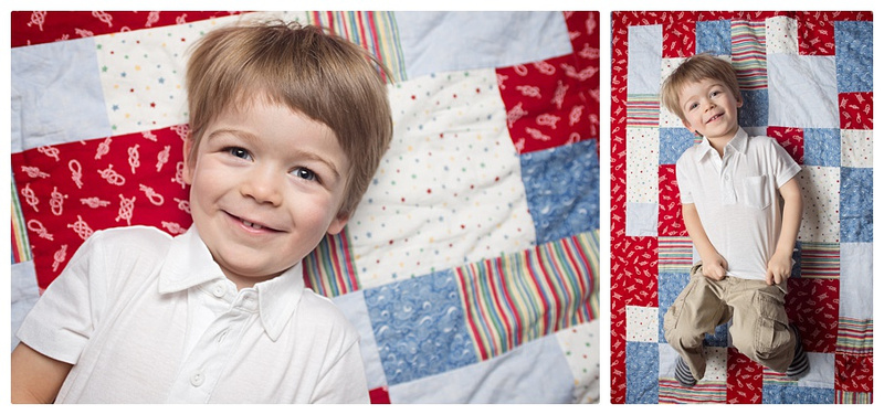 A young boy lies on a hand made quilt during his Tanis Sauicer Photography portrait session in Montreal