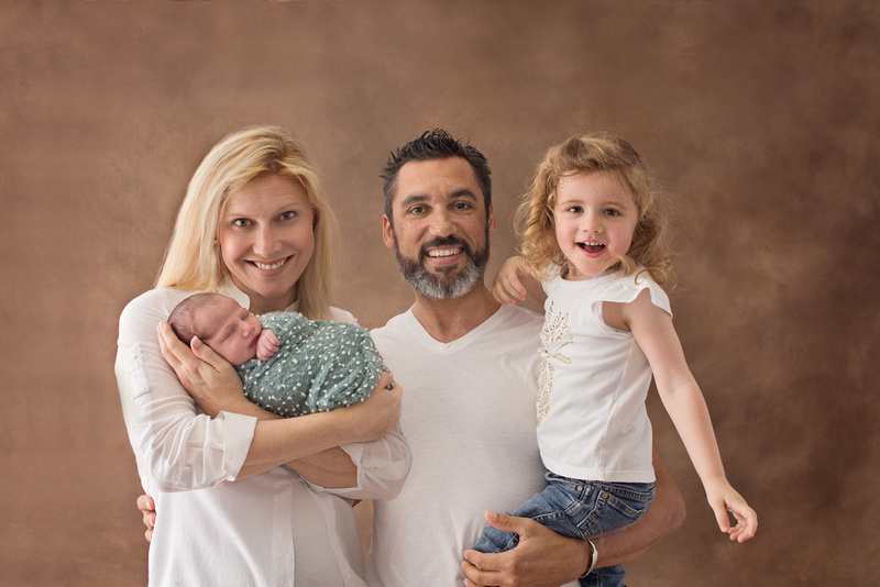 A gorgeous family of four with their newest addition at Tanis Saucier Photography in Montreal.